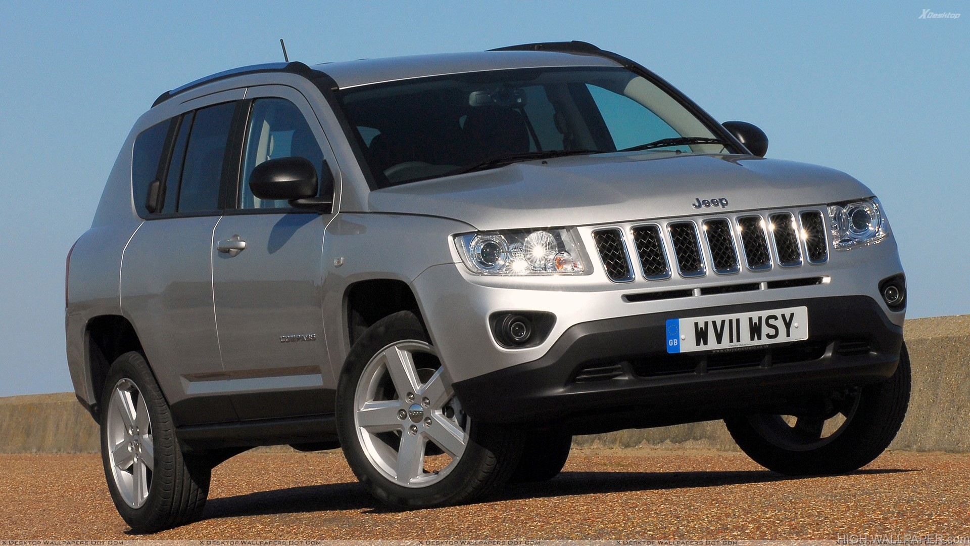 2011 Jeep Compass UK Headlights On in Silver Front Pose