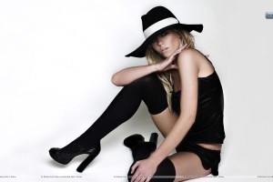 Abigail-Clancy-Sitting-Pose-Wearing-Black-Hat-Dress