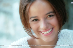 Alizee Jacotey Laughing In White Dress