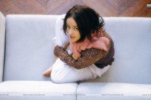Alizee Jacotey Siting On Sofa And Looking Front