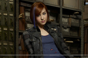 Allison Scagliotti Smiling in Grey Jacket in Warehouse 13