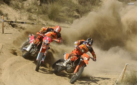 Dirt Bike Racers in Orange