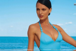 Catrinel Menghia Sitting In Blue Dress At Sea Side