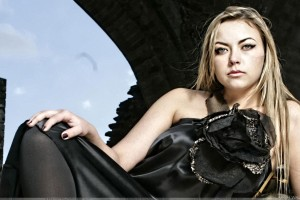 Charlotte Church Siting In Black Dress Looking At Camera