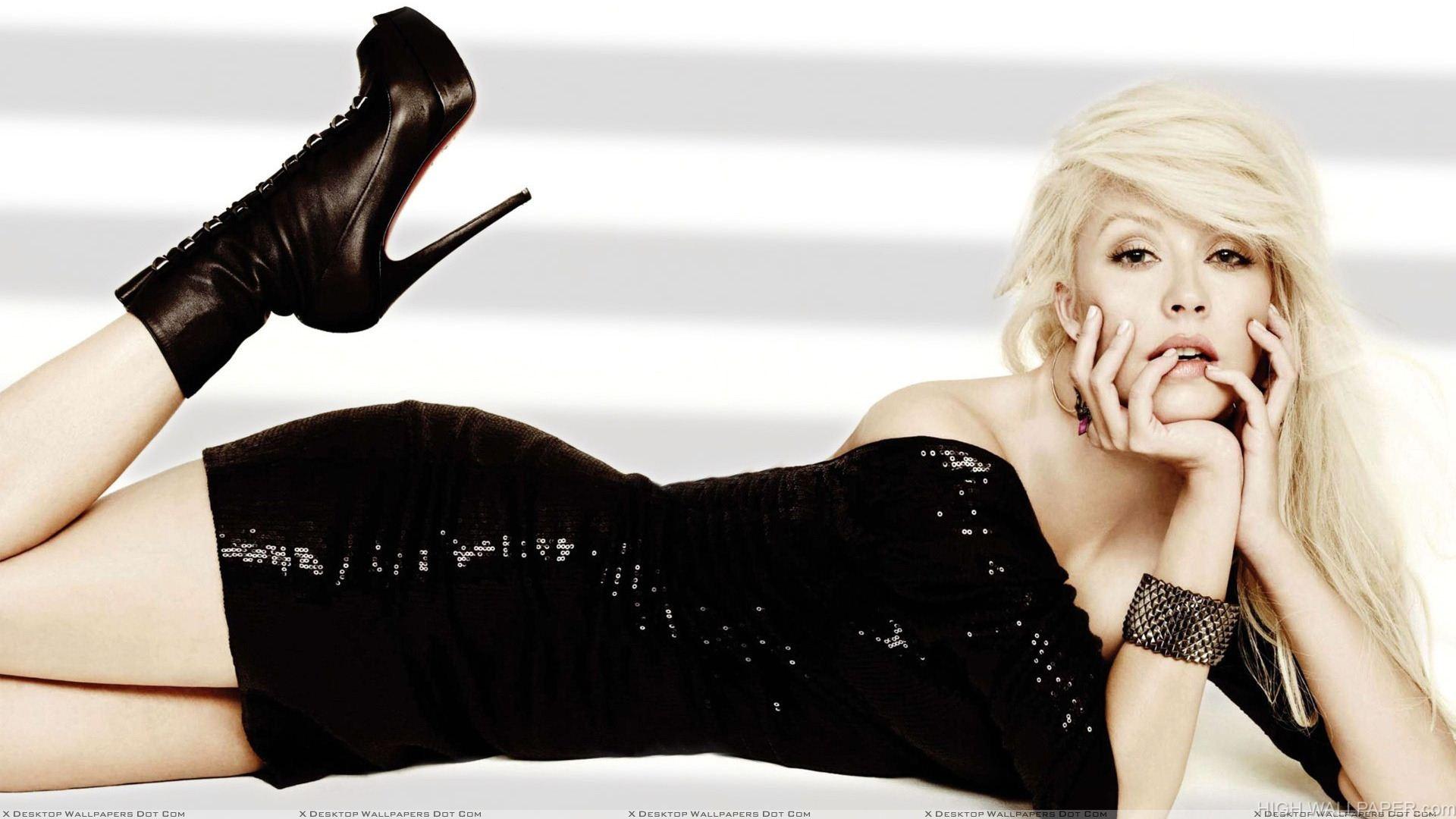 Christina Aguilera Laying Pose In Black Dress