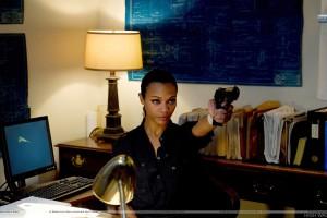 Colombiana Zoe Saldana Holding A Gun In Office