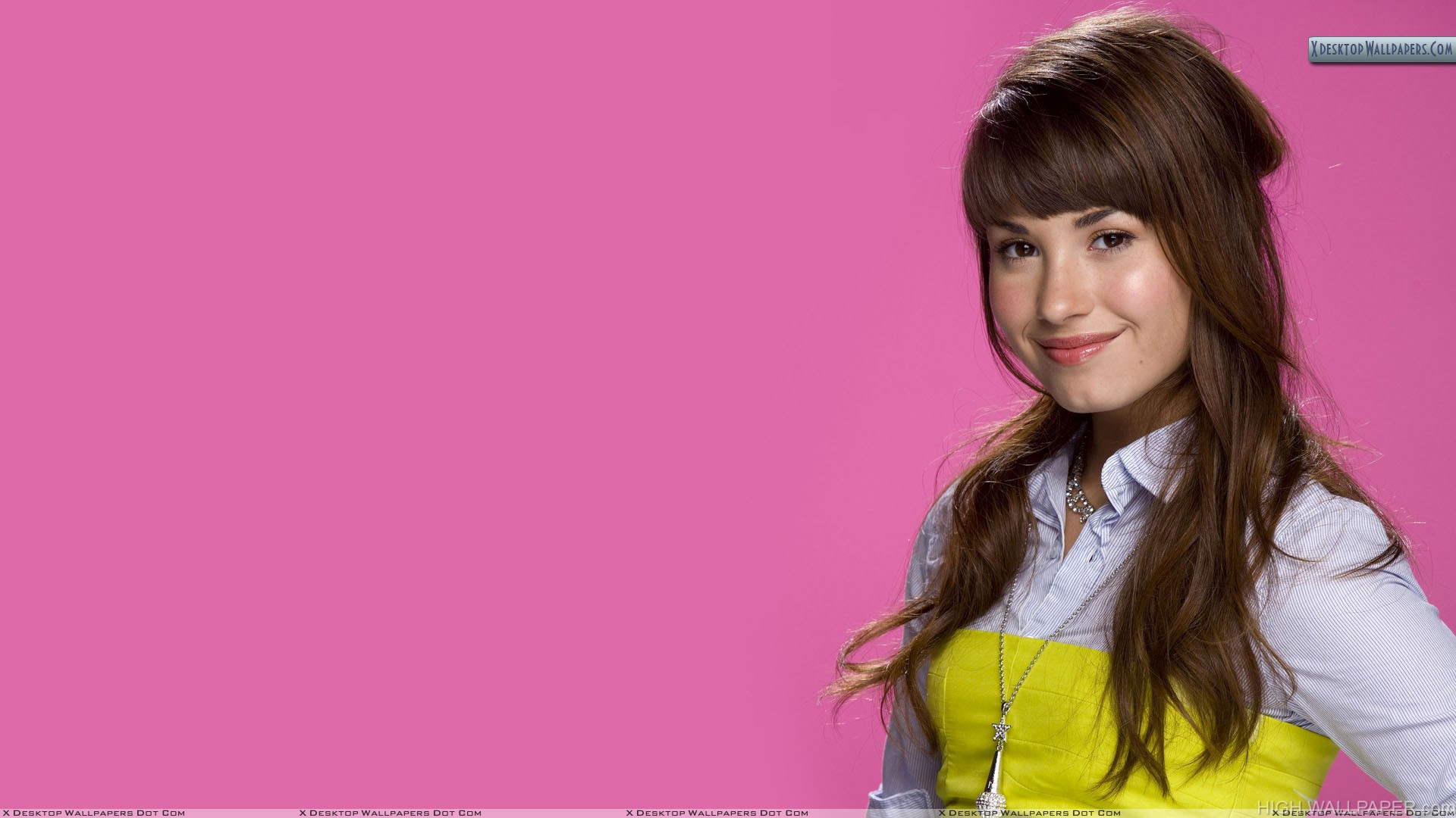 Demi Lovato Smiling In White Top And Pink Background