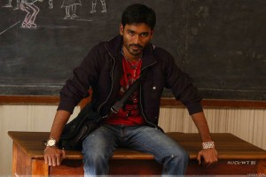 Dhanush Sitting Pose On Table In Classroom In Kutty Movie