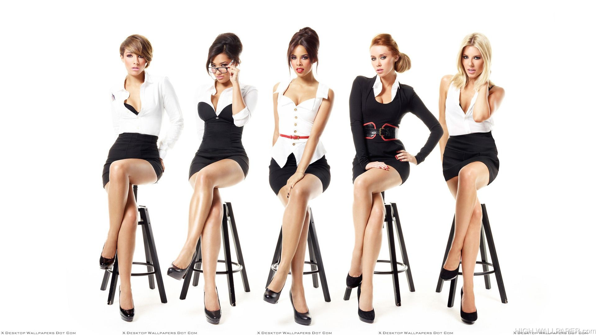 Different Girls With Different Styles Sitting On Chairs