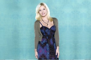 Elisha Cuthbert Smiling In Blue Dress And Green Background