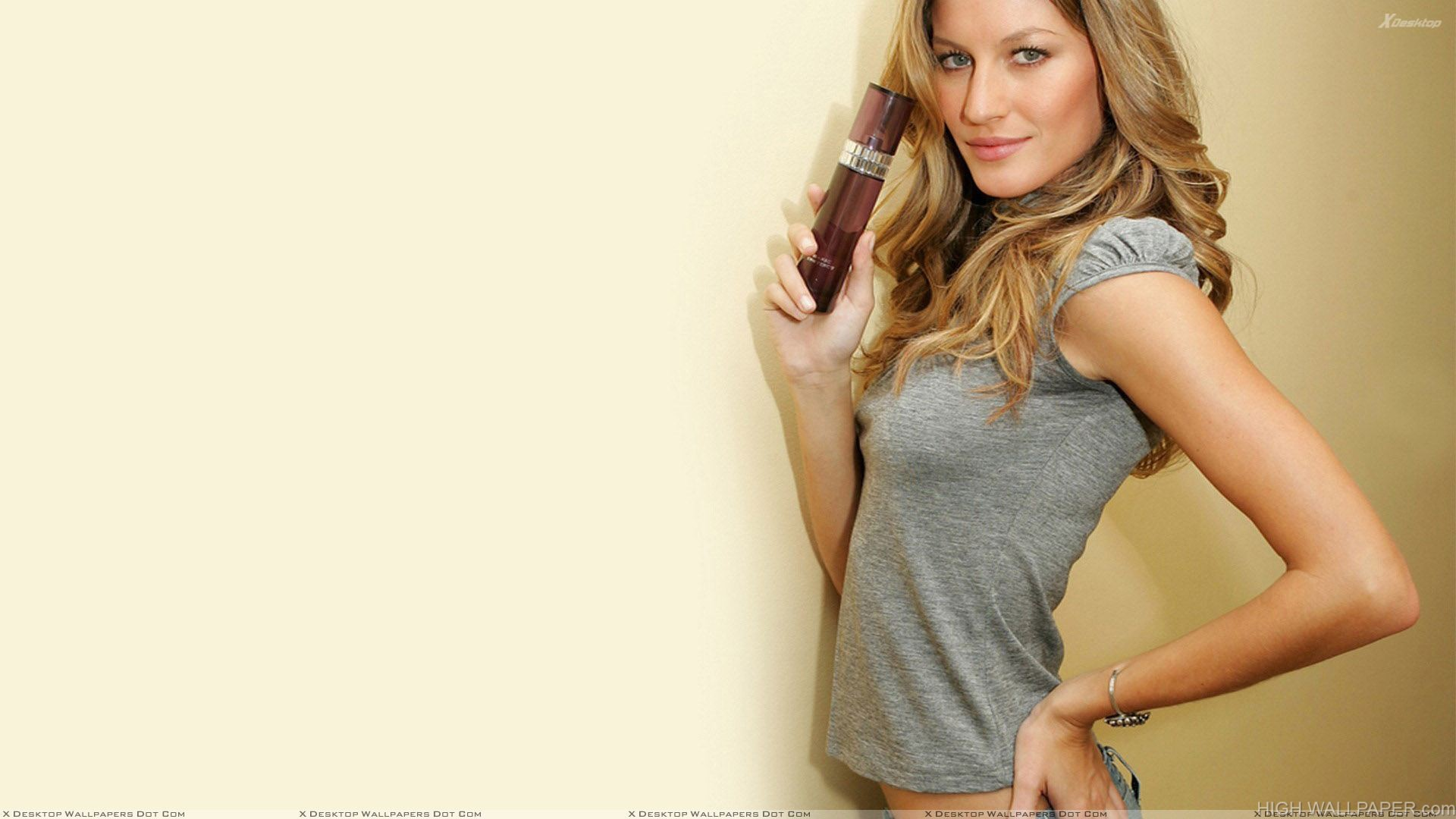 Gisele Bundchen In Grey Top Looking At Camera