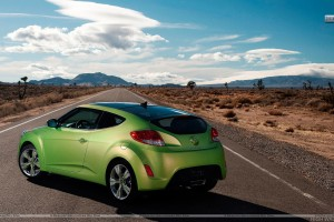 Green Hyundai Veloster Parked on Highway