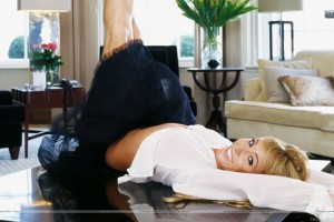 Jenny Frost Laying On Table Black Skirt White Top