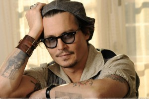 Johnny Depp Looking Smart Sitting Pose