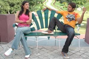 Kajal Aggarwal And Nitin Sitting On Seater In Park   Aatadista