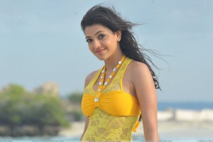 Kajal Aggarwal Smiling Side Pose In Yellow Transparent Dress