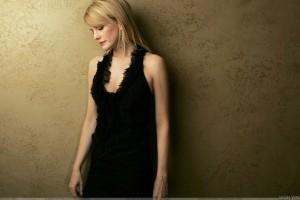 Kathryn Morris Looking Down In Black Dress Side Pose