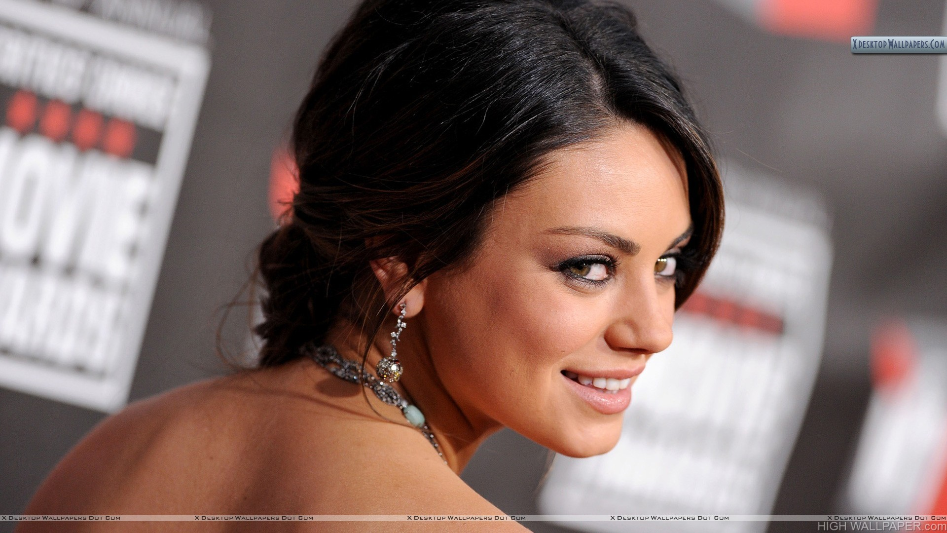 Mila Kunis Smiling Looking Back Side Face Closeup