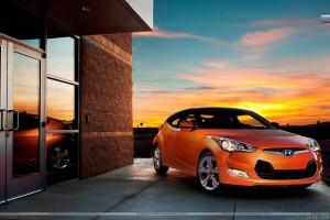 Orange Hyundai Veloster Outside House