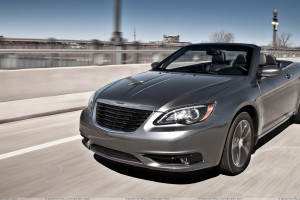 Running Front Pose Of 2011 Chrysler 200 S Convertible In Grey