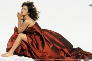 Salma Hayek Sitting Modeling Pose In A Brown Dress