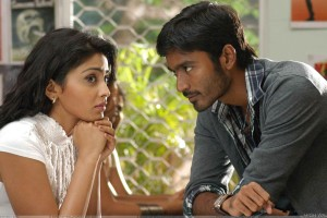 Shriya Saran N Dhanush Sitting Pose In Kutty Movie