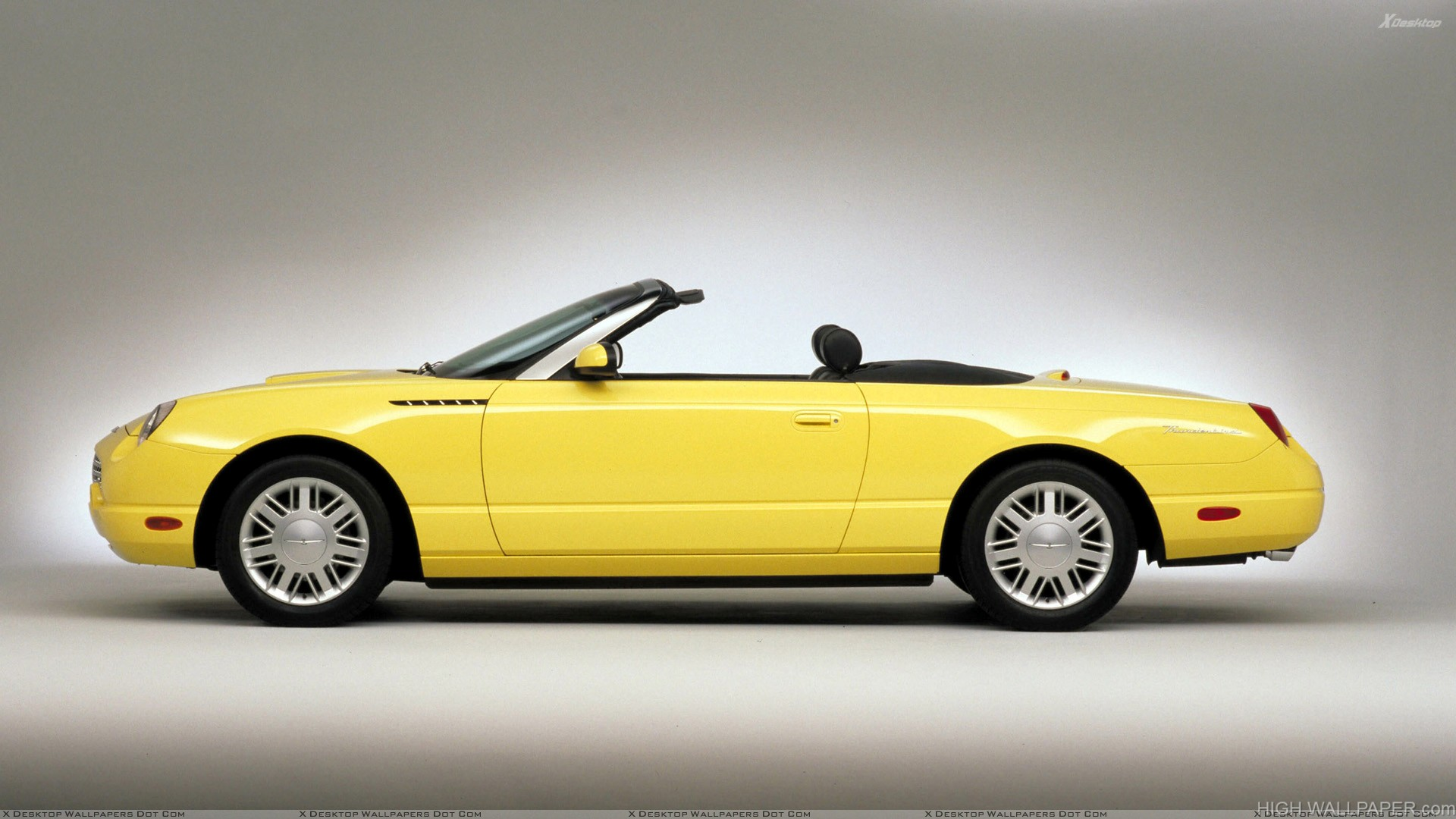 Side Pose Of 2002 Ford Thunderbird In Yellow N Grey Background