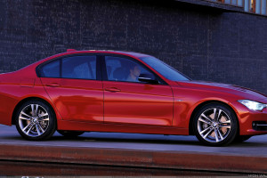 Side Pose Of 2012 BMW 3 Series Sedan F30 In Red