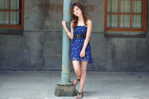 Sweet Asian Girl Lonely Pose With Piller in Blue Dress