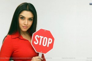 Sweet Looking Asin In Red Shirt With Stop Sign