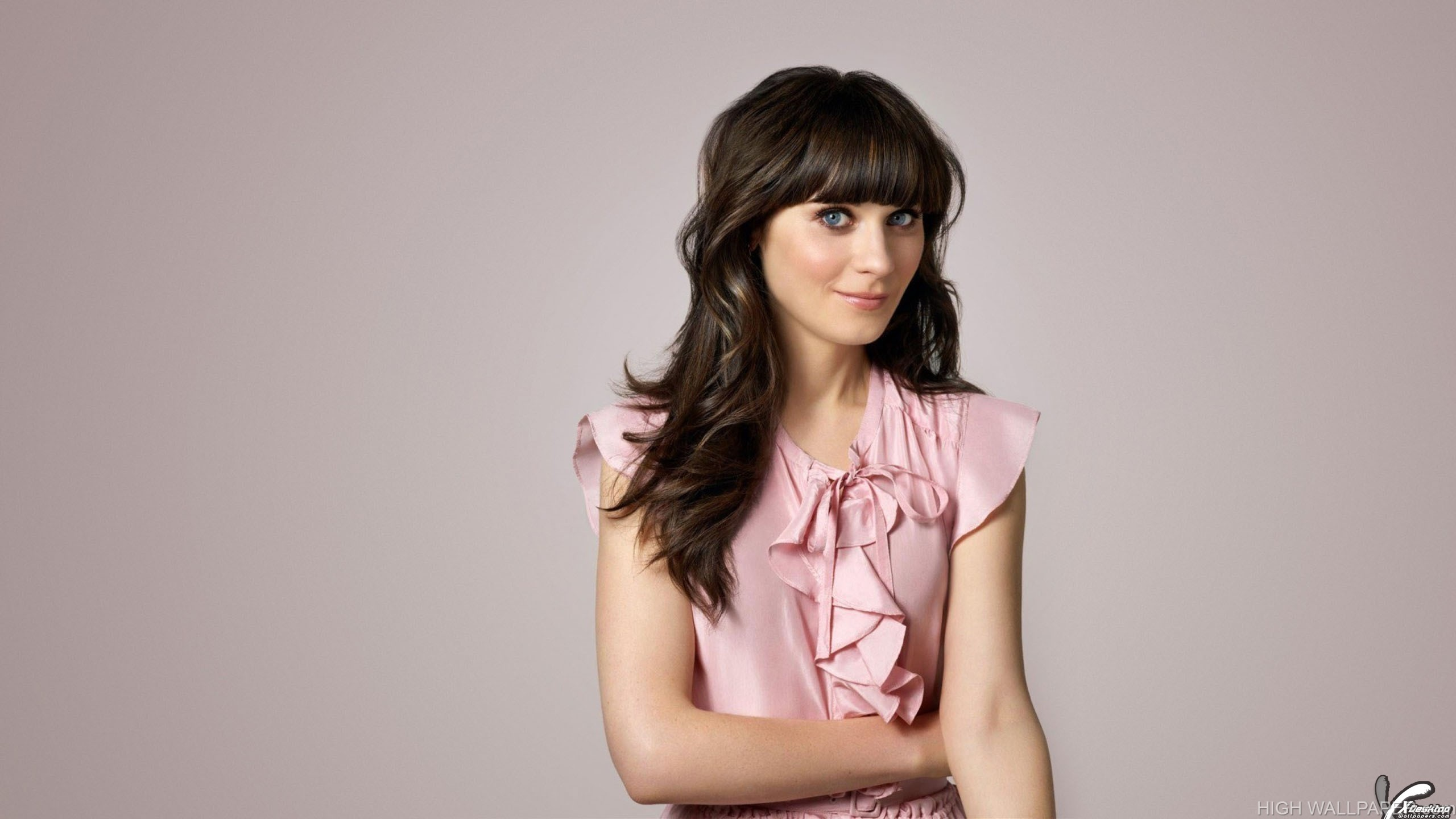 Sweet Zooey Deschanel In Pink Dress Making A Cute Pose