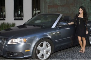 Vanessa Hudgens Smiling In Black Dress Photoshoot With Grey Car