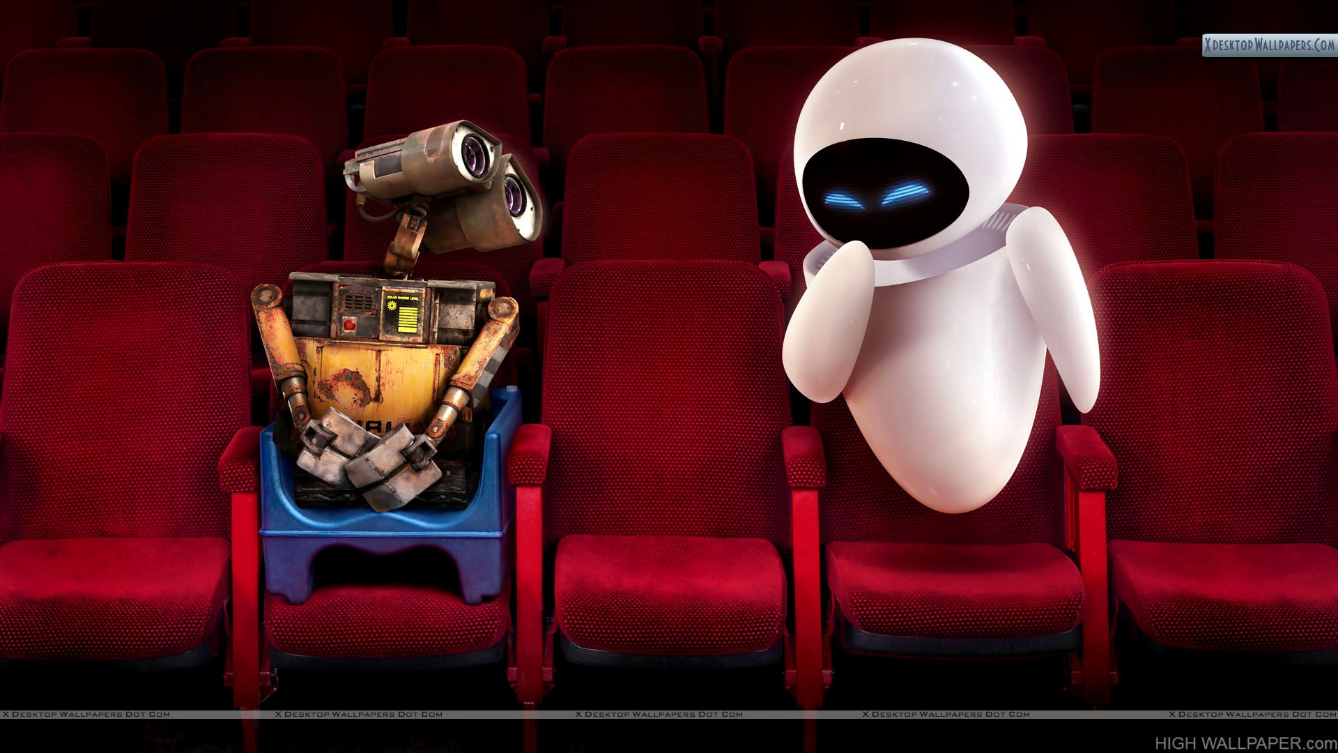 Wall E & Eve Sitting In Theater