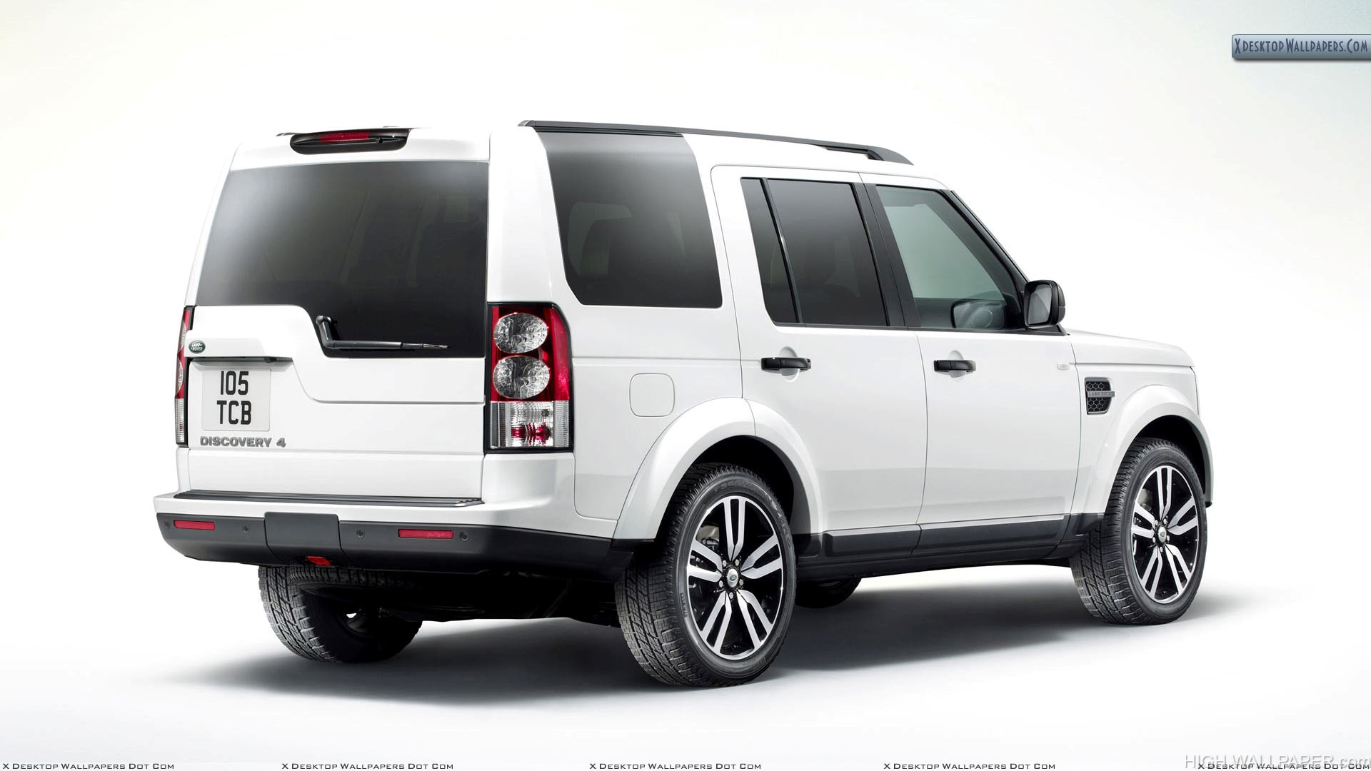 White Color Land Rover Discovery Back Side Pose