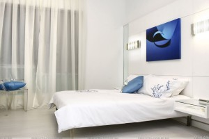 White Interior And White Bedsheet On Bed