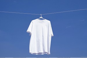 White T Shirt Hanging N Blue Background