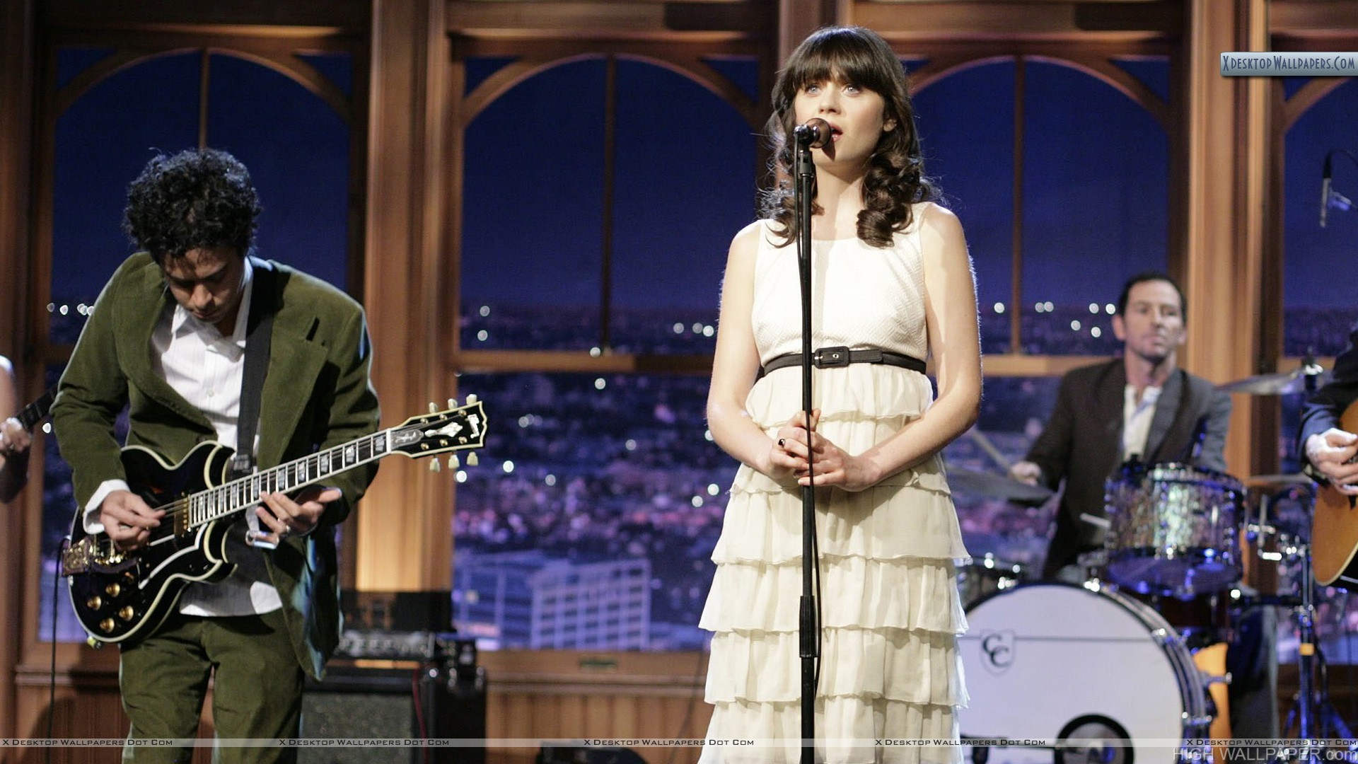 Zooey Deschanel Singing On Stage In White Dress