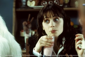 Zooey Deschanel Sitting Drinking Milk Shake